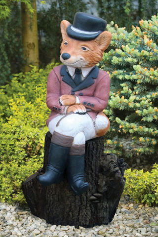Sitting Hunter Boy Fox On Log Pedestal