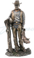 Cowboy Holding Saddle Western Sculpture