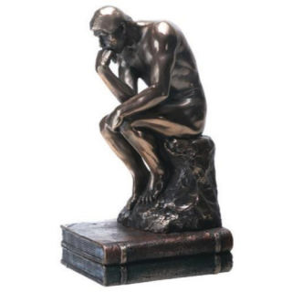 Thinker By Rodin Statue on Books