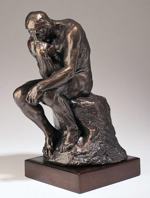 Thinker Statue By Rodin On Wood Base