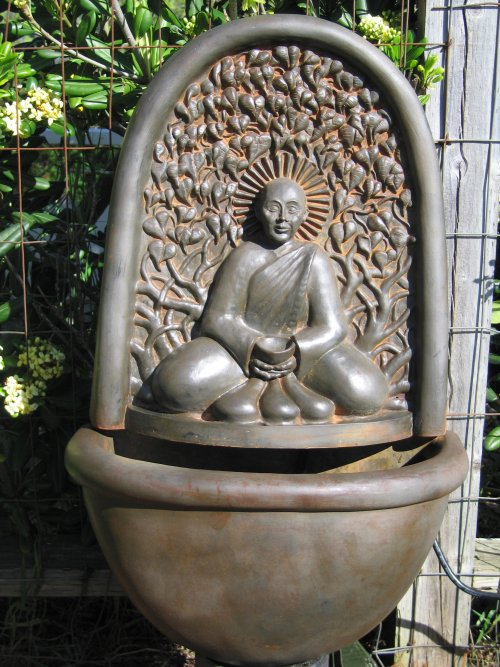 This Monk wall Fountain by artist Sigrid Herr