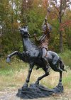 Indian Warrior On A Horse With Tomahawk