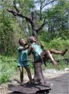 Kids On A Tree Swing