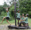 Children Playing Water Pump Feature Statue