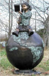 Girl Sitting On A Globe Reading Bronze