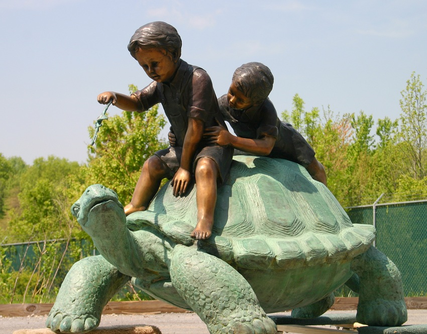 Two Boys Riding Turtle Bronze Statue
