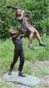 Boy Pushing Girl On Swing Sculpture