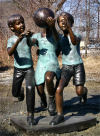Three Kids Playing Basketball Bronze Statue